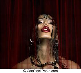 Fashion Beauty. Make-up. Beautiful Sexy Woman With a Luxury glos
