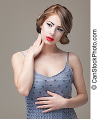 fashion beauty portrait of a blonde, young woman, posing in an e