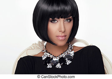 Fashion Beauty Woman Portrait. Stylish Haircut and Makeup. Hairstyle. Make up. Vogue Style. Sexy Glamour Girl. Jewelry.