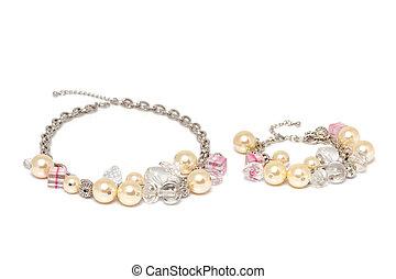 fashion bijouterie - necklace and bracelet on white background