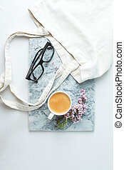 Fashion blog marble style desk with woman accessory: cup of ...