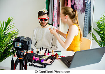 Fashion blogger with male model