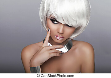 Fashion Blond Girl. Beauty Portrait Woman. White Short Hair. Isolated on Grey Background. Face Close-up. Manicured nails. Hairstyle. Fringe. Vogue Style.