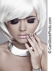 Fashion blond girl with White Short Hair. Manicured nails. Mulatto woman. Eyes makeup. Beauty portrait. Jewelry accessories.