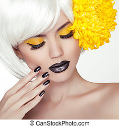Fashion Blond Model Girl Portrait with Trendy Short Hair style, Black Make up and Manicure. Black Nails Polish and Lipstick. Woman Makeup. Haircut.
