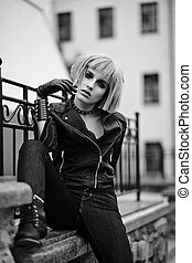 Fashion blond model in teenager style in wig outdoors on the street