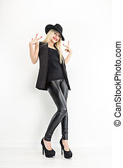 Fashion Blond Woman Portrait in black hat  on White background.
