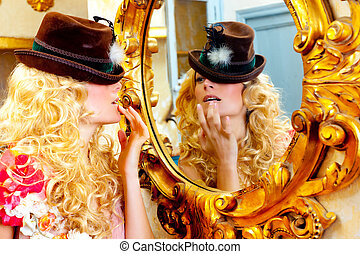 fashion blond woman with hat in baroque golden mirror