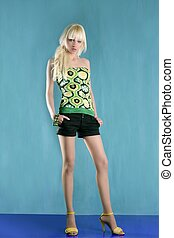 fashion blonde girl full length stand green background