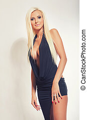 fashion blonde girl with big breasts