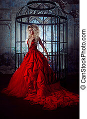 Fashion blonde in red dress with fluffy skirt near the ...