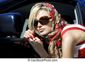 fashion blonde woman - modern fashion blonde woman in dark...