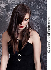 Fashion brunette in black dress