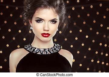 Fashion Brunette Model Portrait. Jewelry and Hairstyle. Elegant