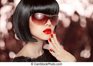 Fashion brunette woman in sunglasses. Black bob hairstyle. Red l