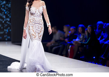 Fashion catwalk runway show models - Female model walks the...