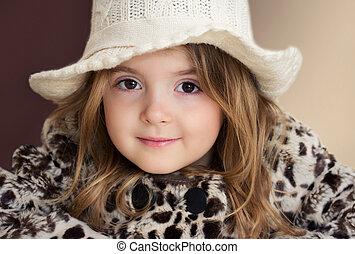 Fashion child portrait closeup. Little girl face.