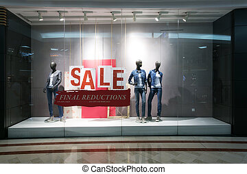 fashion clothes shop display window and sale sign.