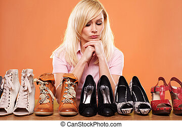 Fashion conscious woman with shoes - Fashion conscious woman...