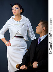 Fashion couple - Portrait of young couple dressed in elegant...