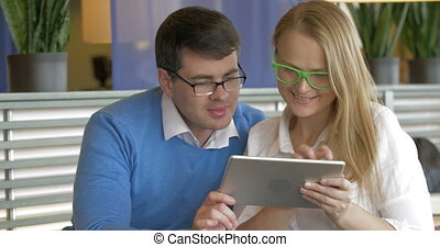 Fashion Couple Using A Tablet