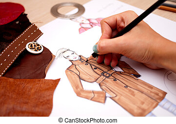 Fashion Design - Fashion designer is drawing a fashion...