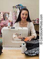 Fashion designer at sewing machine