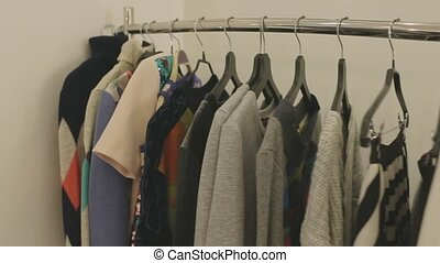 fashion designer clothes on hangers in the store