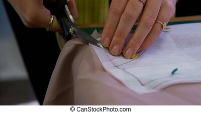 Fashion designer cutting fabric 4k - Fashion designer ...