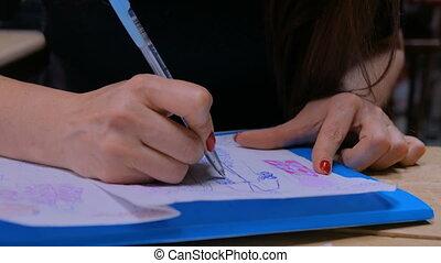 Fashion designer drawing design sketch - Close up shot -...