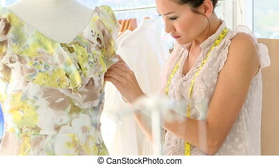 Fashion designer fixing dress
