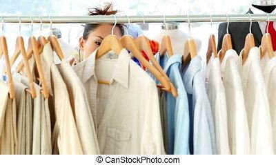 Fashion designer looking through her studio