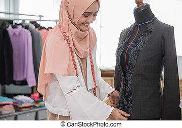 fashion designer make a clothing