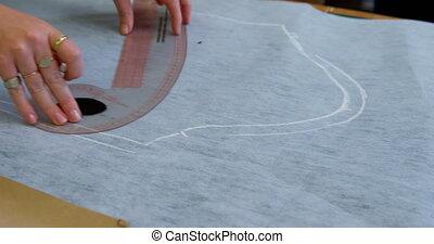 Fashion designer marking on fabric with chalk 4k - Fashion ...