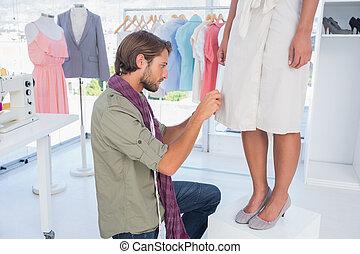 Fashion designer picking needles
