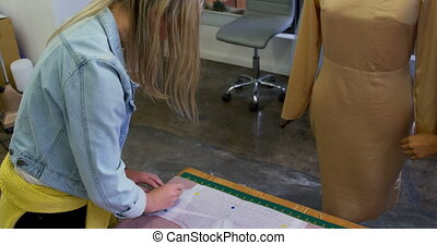 Fashion designer pinning on cloth 4k - Fashion designer ...