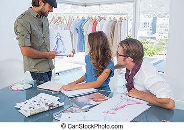 Fashion designer presenting his dra