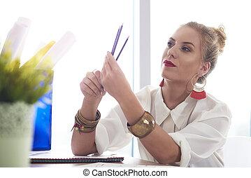 Fashion designer sharpened her pencils