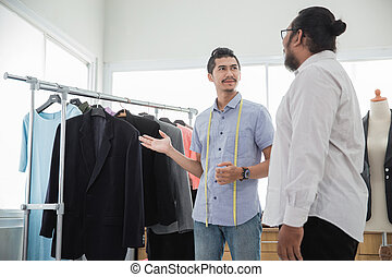 fashion designer showing his product