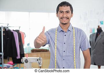 fashion designer showing thumb up to camera