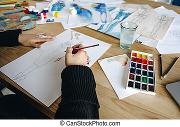 fashion designer sketching