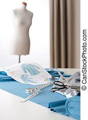Fashion designer studio with professional equipment,...