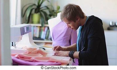 fashion designer with cloth making dress at studio - people,...