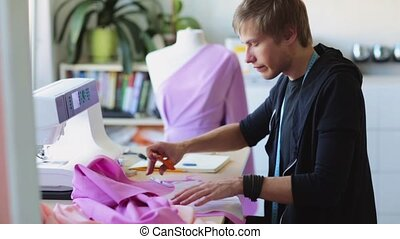 fashion designer with cloth making dress at studio - people,...