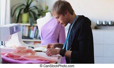 fashion designer with cloth making dress at studio - people...