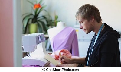 fashion designer with notebook working at studio - people,...
