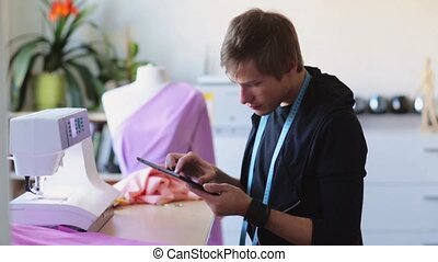 fashion designer with tablet pc working at studio - people,...