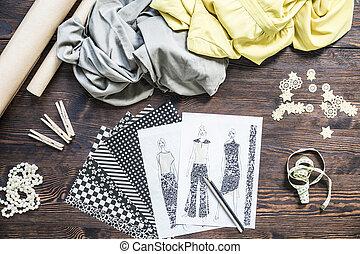 Fashion designer work place - Wooden desktop with fasion ...