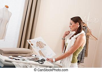 Fashion designer working at studio