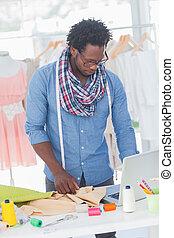 Fashion designer working on his laptop